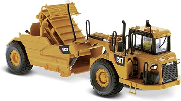 Máy kéo bánh xe được sử dụng để làm phẳng bề mặt đất thông qua việc cào bóc đất